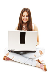 Attractive teenage girl using notebook computer