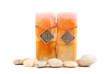 Two Asian Marbled Candles with Rocks