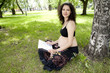 beautiful pregnant woman read book in the park
