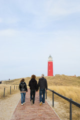 People walking to lighthouse