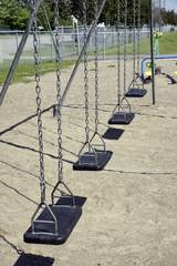 Empty black swings vertical