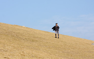 man walking on the mountain