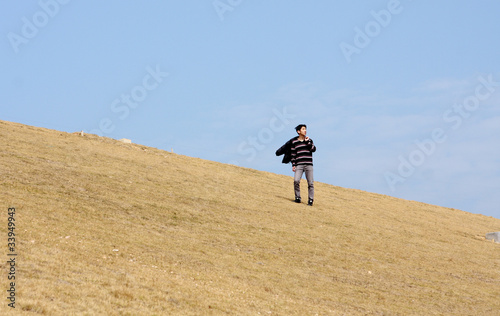 man walking on the mountain