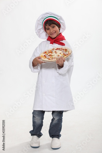 Little boy dressed as pizza chef