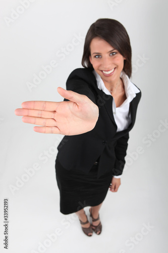 Smart woman showing the palm of her hand