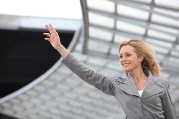 Businesswoman waving