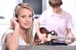 Teenagers listening to music on headphones
