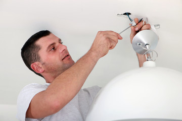 Man fixing light at home