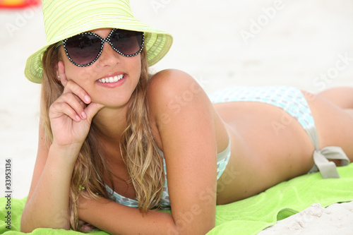 Attractive blond woman sunbathing at the beach