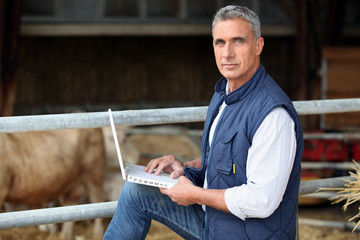 farmer working on his laptop