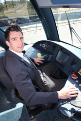 Young man driving tram