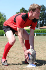 Man stood on rugby pitch preparing penalty kick
