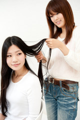 beautiful asian women taking care of her hair