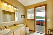 Bathroom with open exterior door and tub