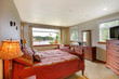 Bedroom with water view and red bed