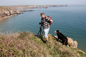 A male photographer on the Pembrokeshire coastline