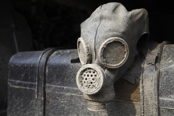 Old dirty gas helmet as a symbol of destruction