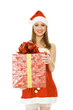 Cheerful santa helper girl with gift box. Isolated over white