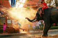 """Постер, картина, фотообои """"Play with the Chang Songkran water."""""""