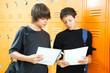 Teen Boys Comparing Homework