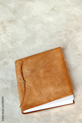 Suede Book on Marbled Background