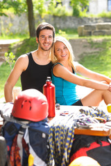 Young couple relax sunny terrace climbing gear