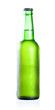 Cold chilled beer in green bottle with condensate isolated on a