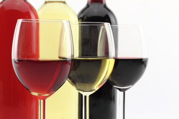 Three colors of wine in bottles and glasses