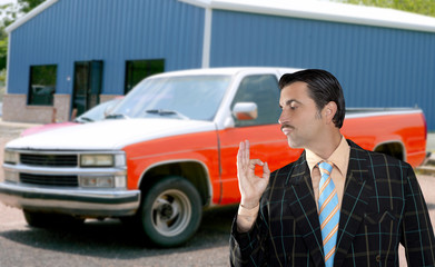 car used salesperson selling old car as brand new