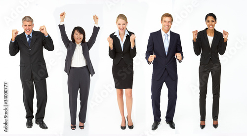 Triumphant group of businessmen and women