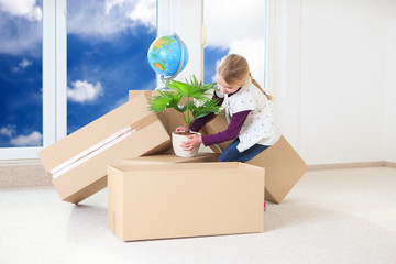 girl helping moving house blue sky window