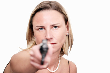 Tough blonde woman raises a gun
