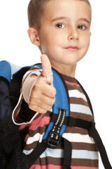 Little boy with backpack shows thumb up sign