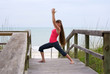 woman doing yoga exercise warrior 1 pose