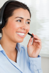 Portrait of an attractive woman with a headset helping customers