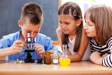 Boy looking into microscope
