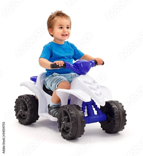 Little boy on toy car