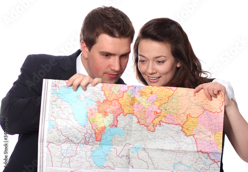 happy casual couple with map isolated on the white