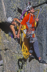 Team of climbers reaching the summit.