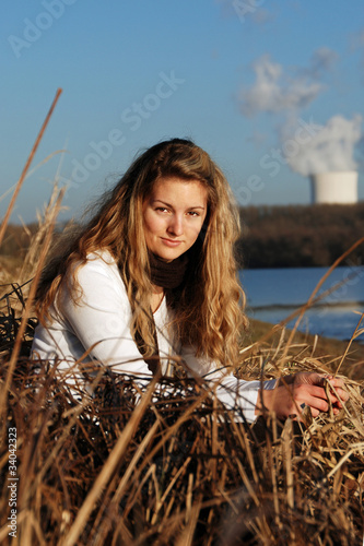 Young girl and atomic power plant