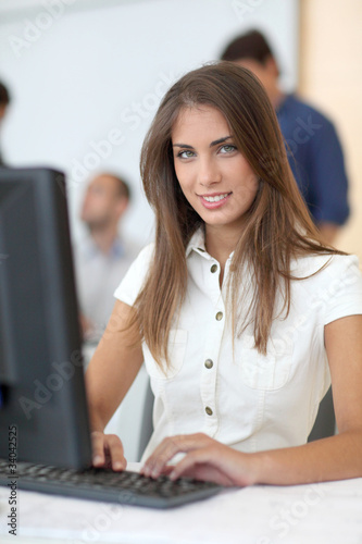 Portrait of student in front of desktop computer