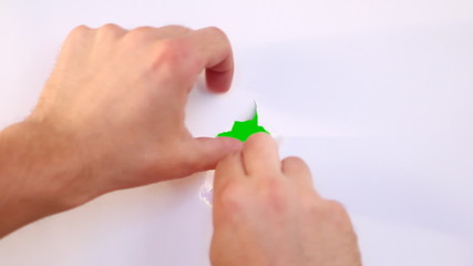 Making hole in the white paper