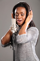 Sing song african american girl recording studio