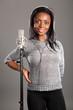 Happy smile by beautiful girl singer in studio