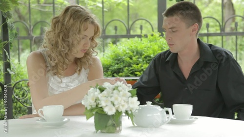 Dating romantic young couple eating dessert,