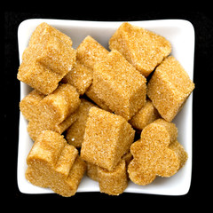 brown sugar in a white bowl on black