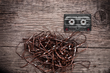Cassette on wooden background