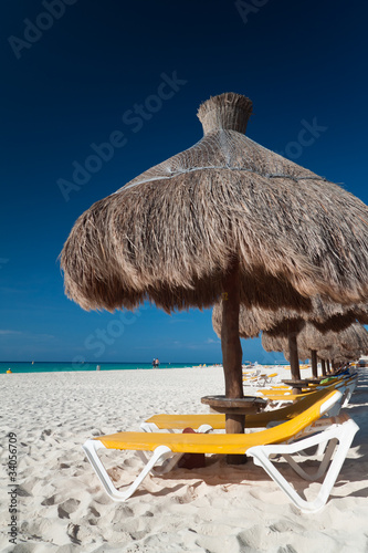 Relaxation under parasol at Caribbean Sea