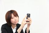 Princess MAIKO Benicio / Smile with Smart Phone at Office