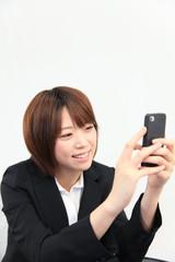 Princess MAIKO Benicio / Laugh with Smart Phone at Office